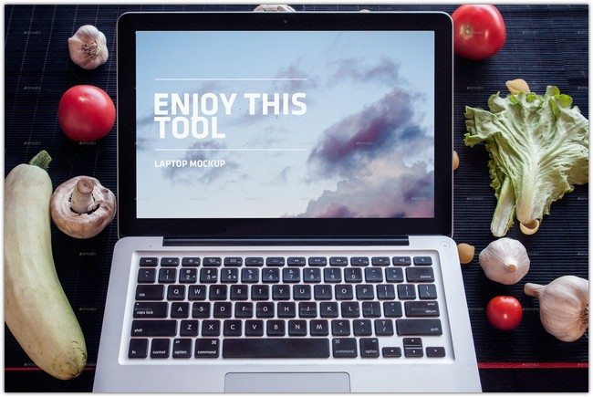 Laptop near Vegetables