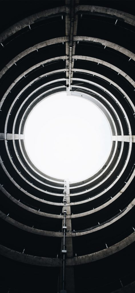 Black iPhone Wallpaper Circular Building-1125x2436