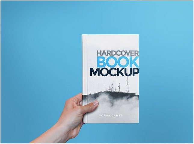 Hardcover Book In Hand Mockup psd