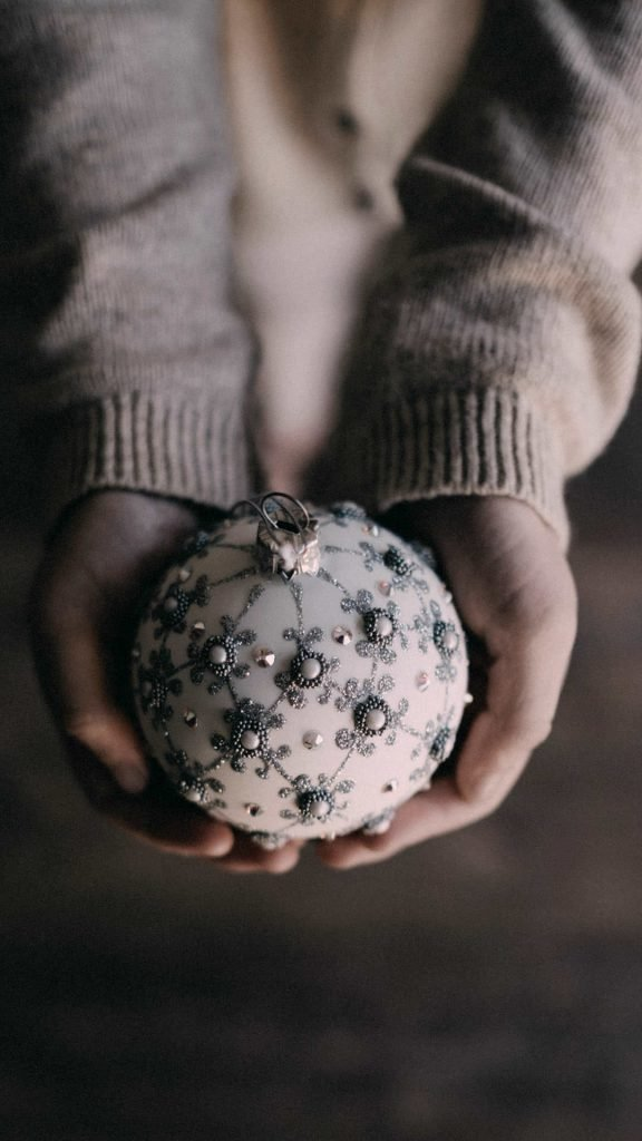1080 × 1920 Christmas Ball in Hand iPhone 7 wallpaper