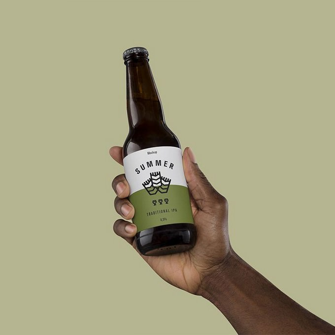 Free Hand Holding Beer Mockup