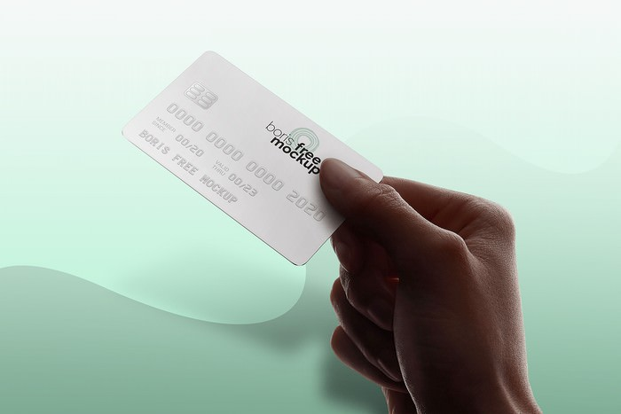 Free PSD Hand Holding Credit Card Mockup