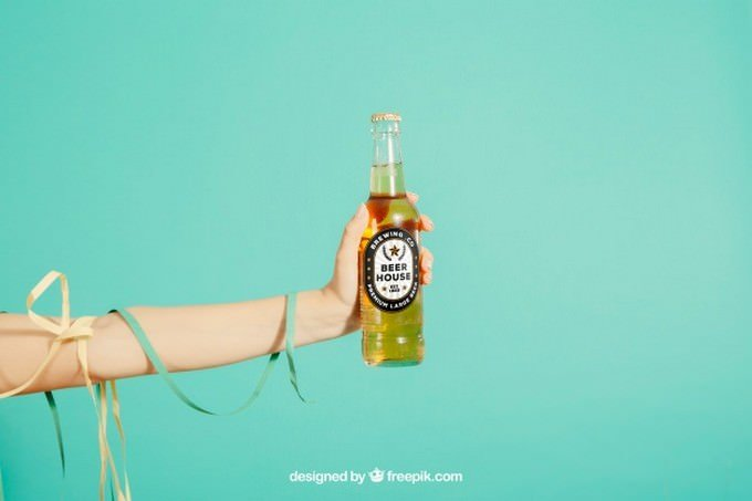Party Concept With Arm Holding Beer Bottle