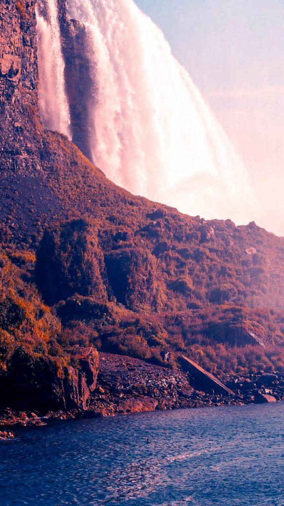 1080x1920-ios waterfall sea rocks HD Wallpaper