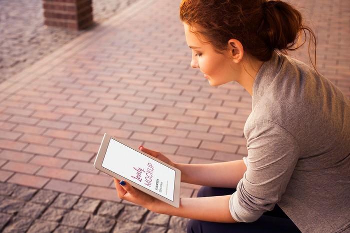 Woman Holding iPad Mockup PSD