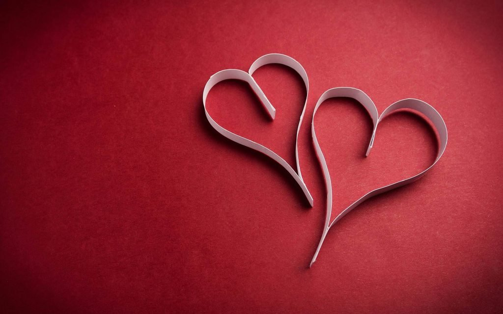 Two Paper Hearts on Red Girly Background