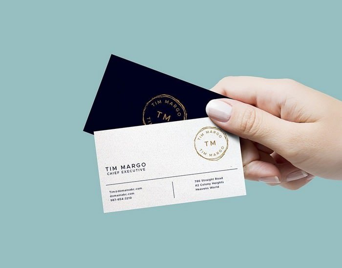 Hand Holding Business Cards Mockup PSD