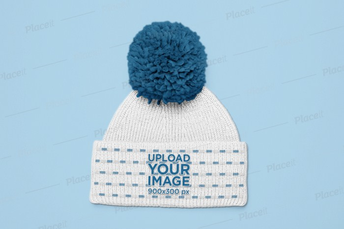 Mockup of a Pom Pom Beanie Lying Flat on a Surface