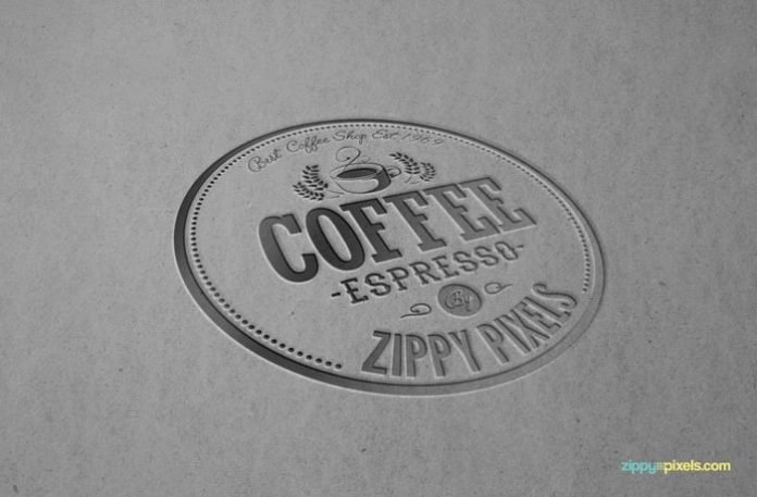 Logo with letterpress effect on a cardboard surfac.