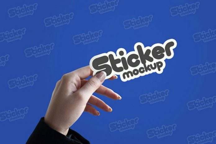 Free In-hand Sticker PSD Mockup